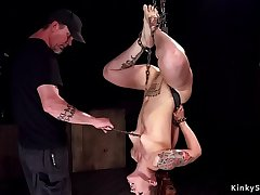 Chained and suspended redhead following