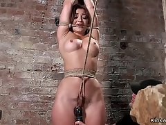 Busty slut gets weighted crotch rope