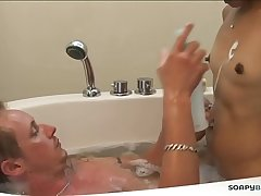 Asian masseuse jerking a large white cock