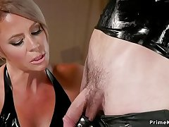 Milf blonde submits male in ribber suit
