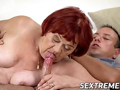 Redhead grandma gives head before passionate banging