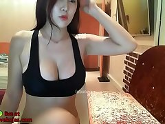 Busty Korean shows her huge natural tits