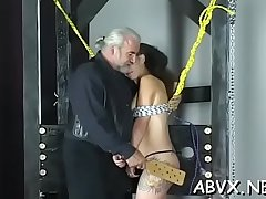 Hot scenes of rough bondage on busty babe'_s bawdy cleft
