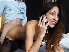 Great looking babe is talking with her boyfriend  on the phone  while getti