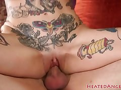 Inked spex babe with fake tits gets banged