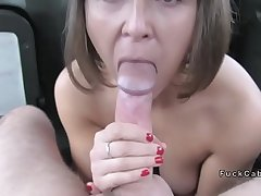 Natural busty lady gives footjob in cab