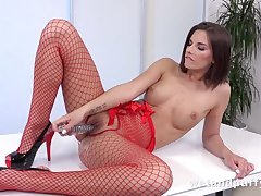 Stunning MILF in red fishnets plays solo with dildo