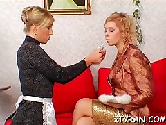 Dude gets walked around on a chain in some titillating femdom action
